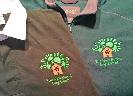 Fleece and rugby shirt with the New Forest Dog Hotel Hampshire logo for the new uniforms home dog boarding